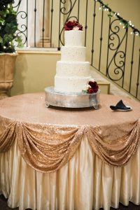 Wedding Reception Hall White and Red Cake Display