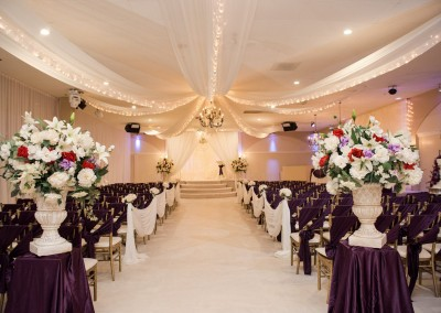 Indoor Wedding Ceremony Deep Purple and White Decor