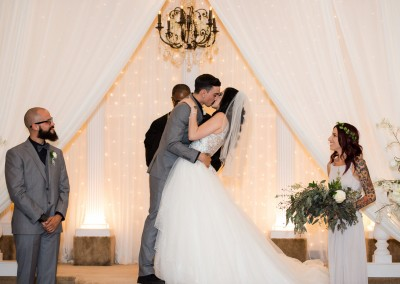 Villa Tuscana Reception Hall event showing indoor Wedding Ceremony Kiss the Bride