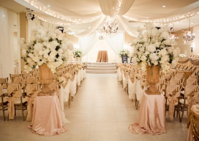 Villa Tuscana Reception Hall event showing Indoor Wedding Ceremony Light Pink Decorations