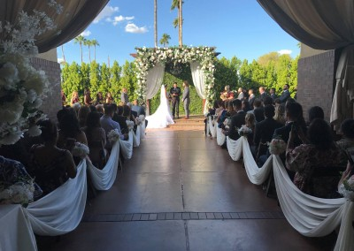 Villa Tuscana Reception Hall event showing outdoor wedding ceremony