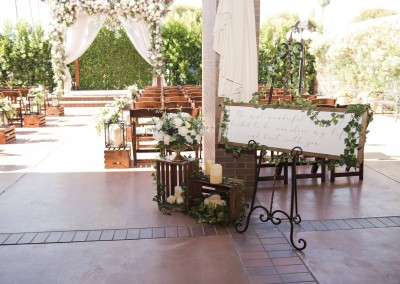 Villa Tuscana Reception Hall event showing outdoor wedding ceremony decor rustic