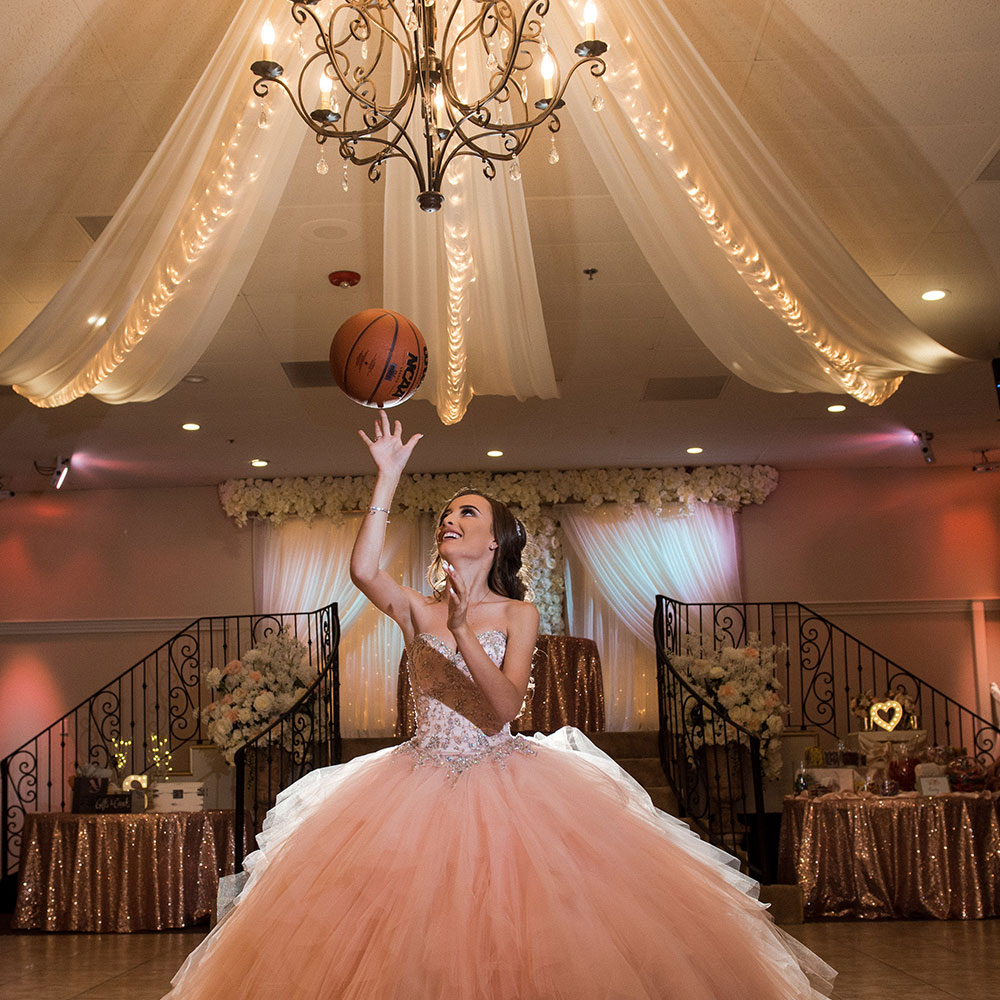 Villa Tuscana Reception Hall in Mesa for Weddings and Quinceanera showing girl in reception hall with basketball