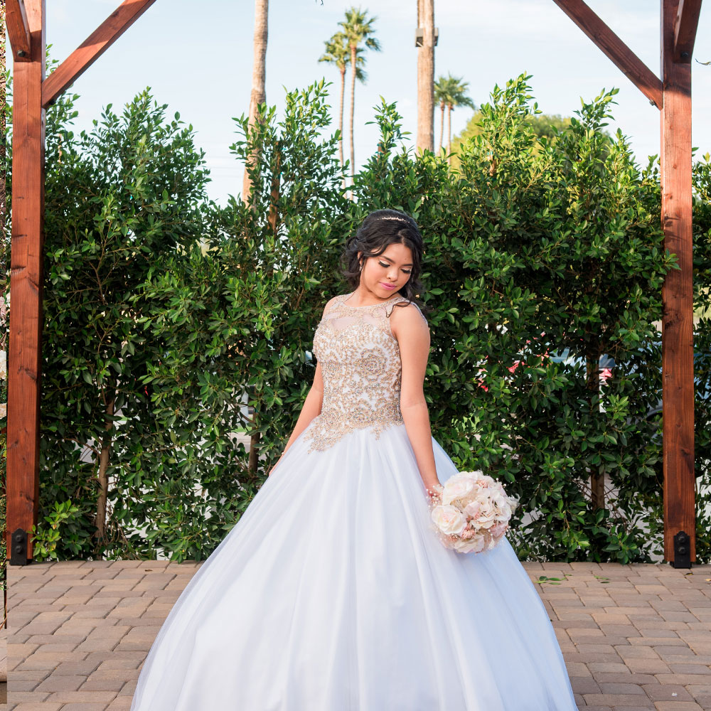 Villa Tuscana Reception Hall in Mesa for Weddings and Quinceanera showing girl in white dress