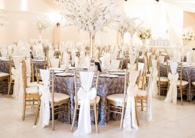 Villa Tuscana Reception Hall event showing floral whites and lavender table decor
