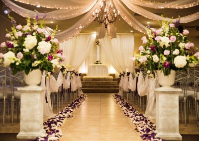 Villa Tuscana Reception Hall event showing indoor ceremony space and aisle