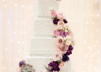 Villa Tuscana Reception Hall event showing wedding cake with flowers