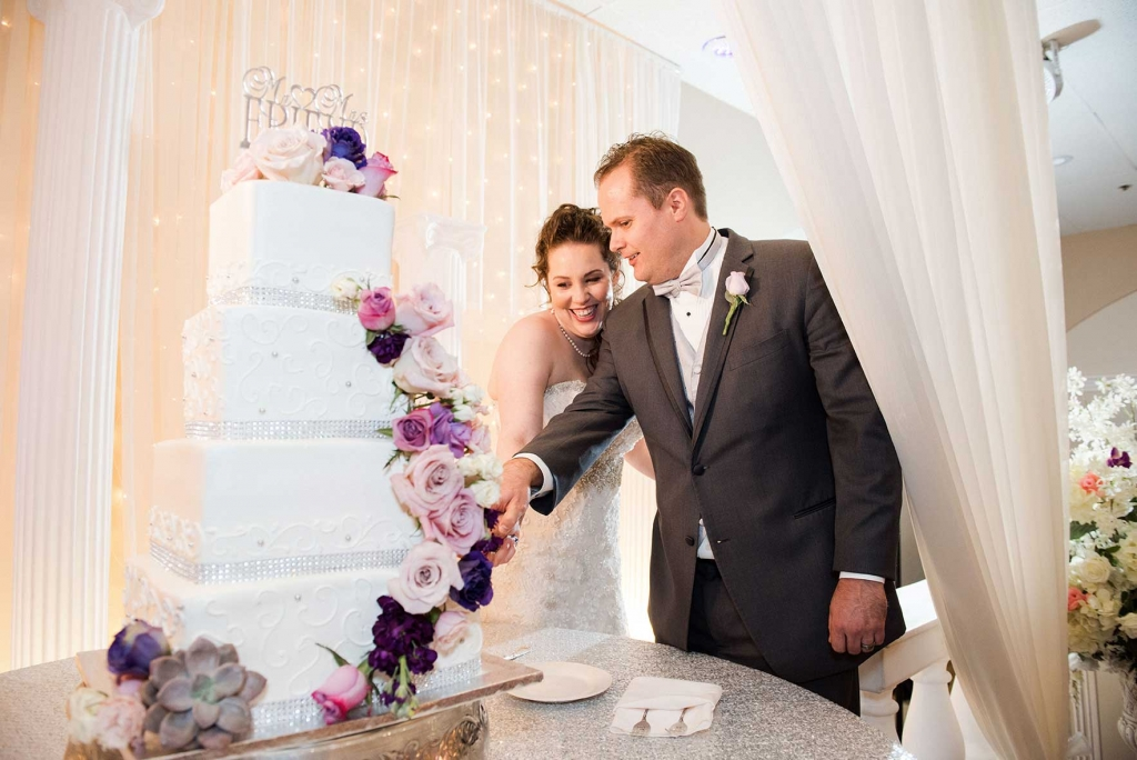 Villa Tuscana Reception Hall event showing couple cutting wedding cake