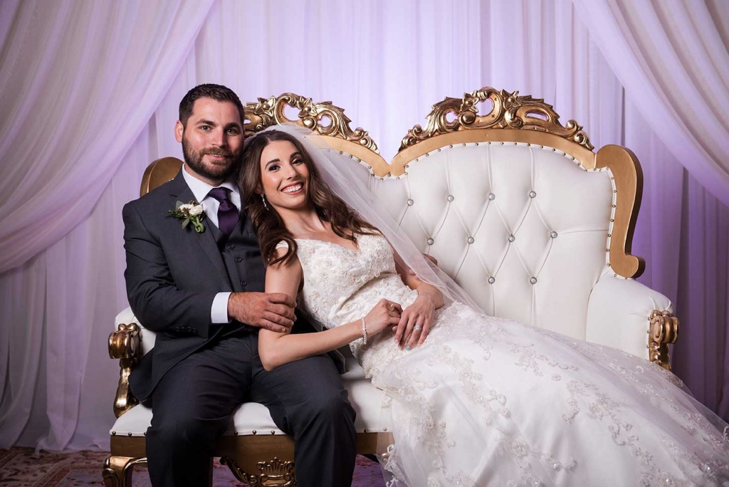 Villa Tuscana Reception Hall event showing bride and groom in chair