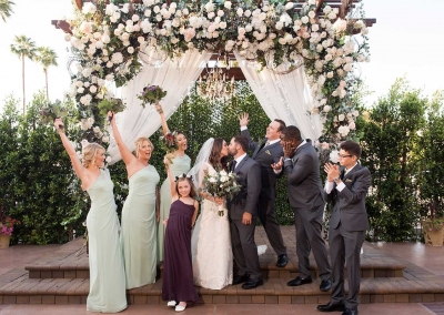 Villa Tuscana Reception Hall event showing family in outdoor ceremony