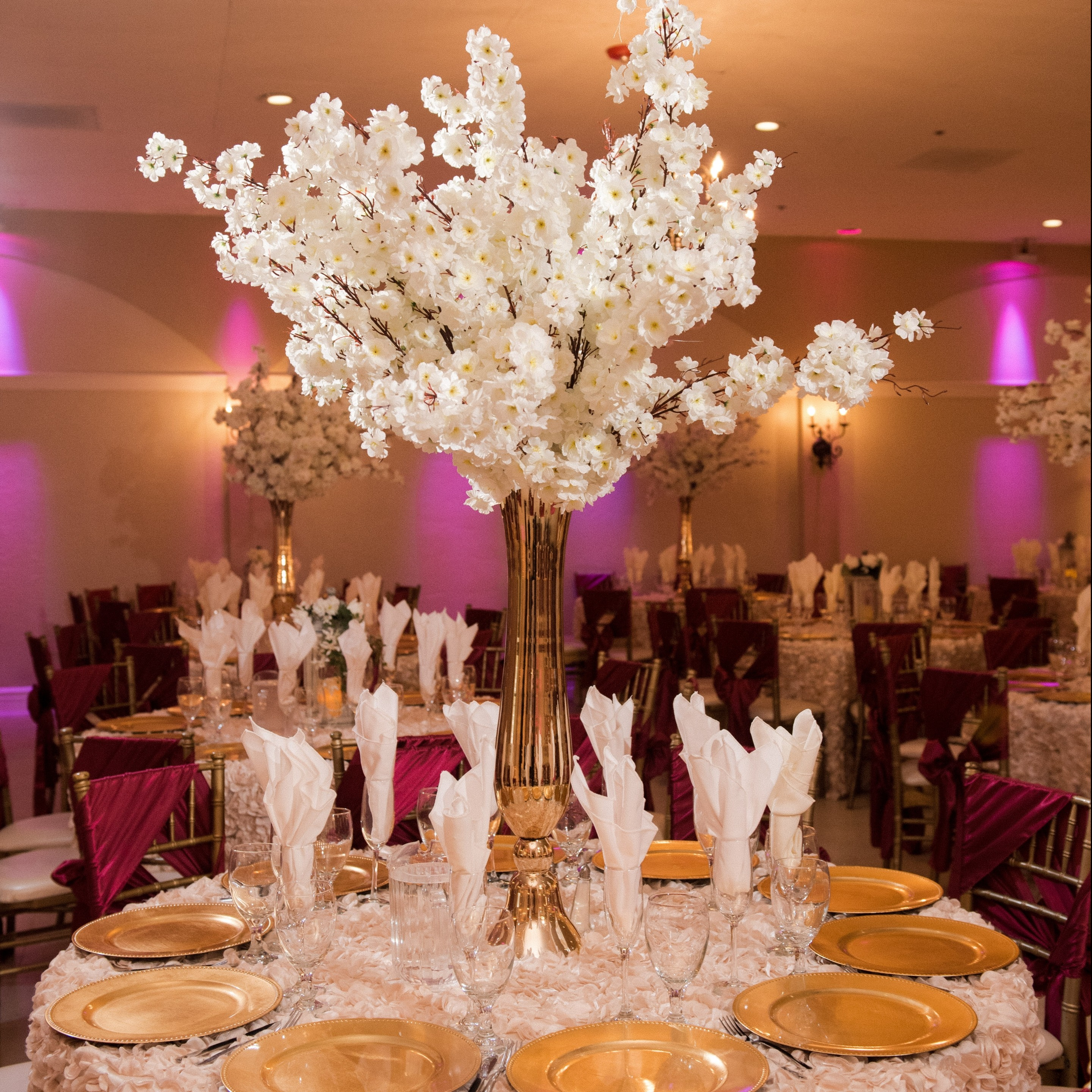 Villa Tuscana Reception Hall event showing large white floral centerpiece table decoration