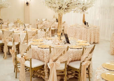 Pale white and pink wedding reception decor