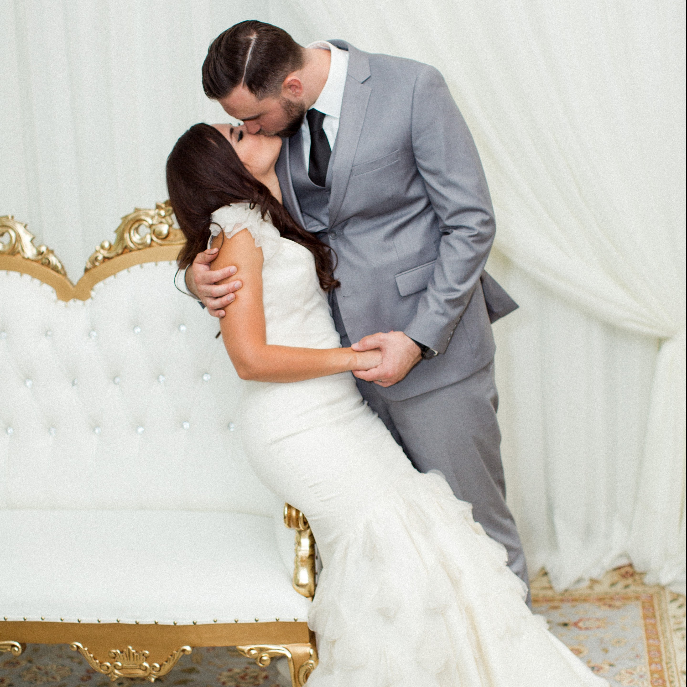 Villa Tuscana Reception Hall event showing couple kissing during photos