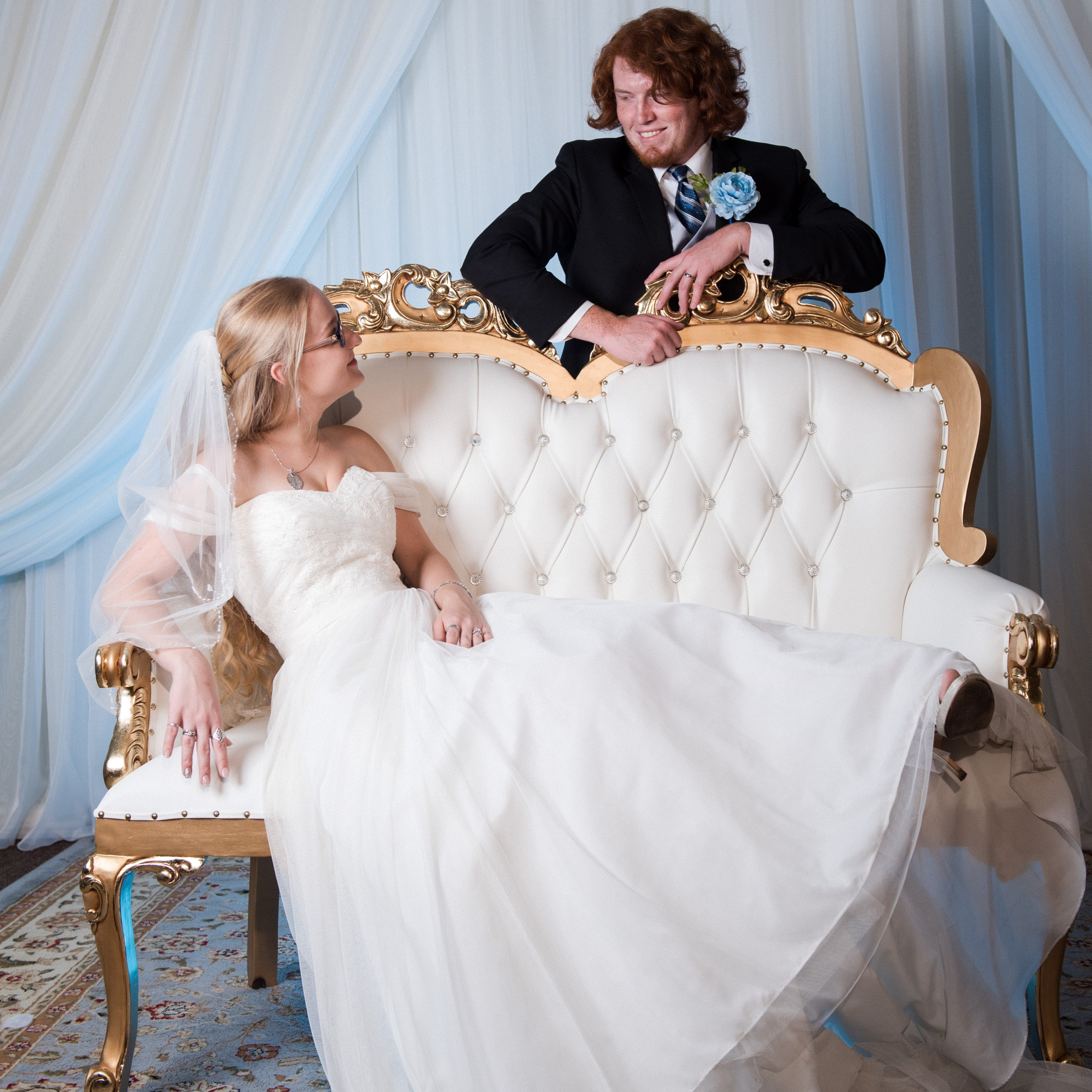 Villa Tuscana Reception Hall event showing bride and groom sitting on decorative couch