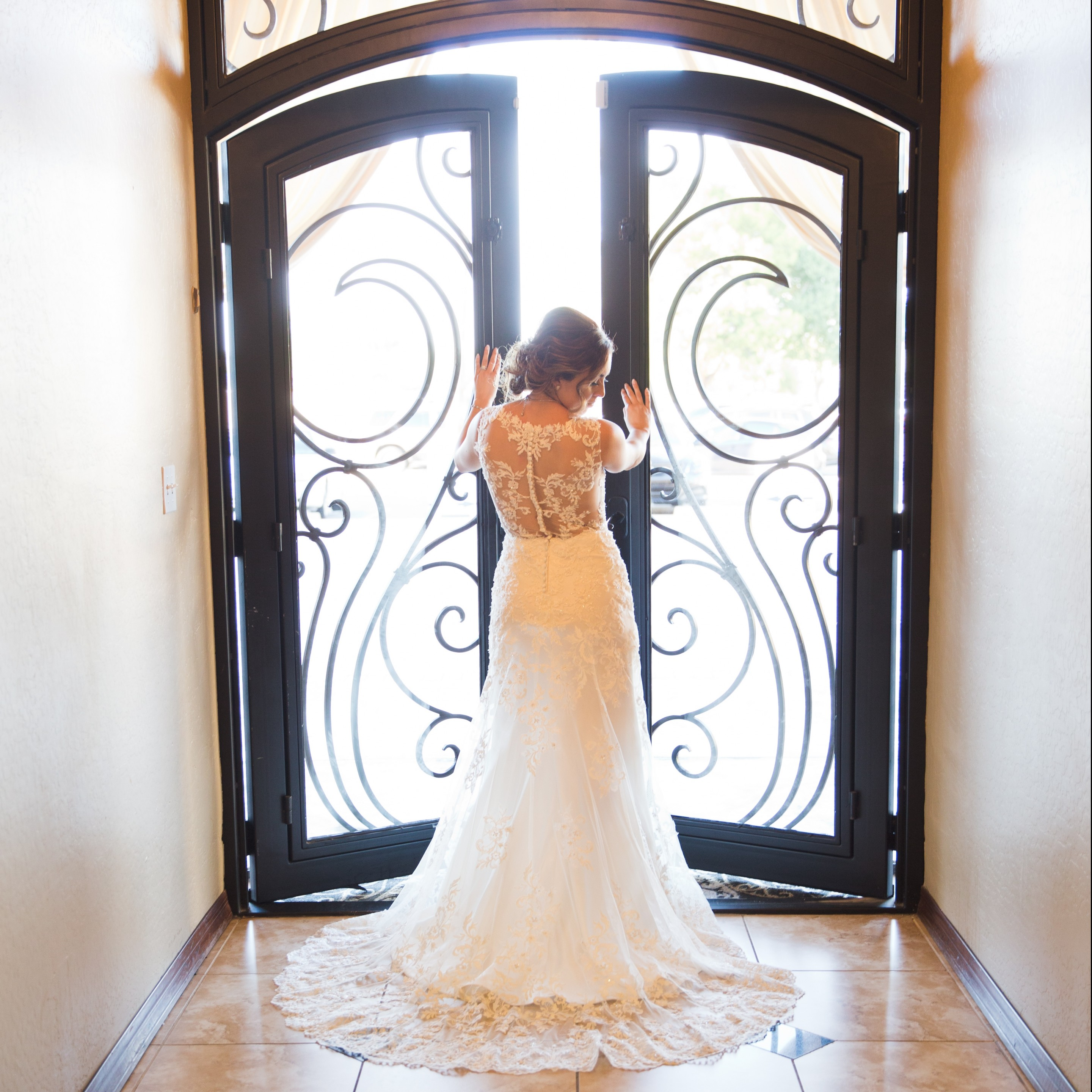 Villa Tuscana Reception Hall event showing back of wedding dress inside reception hall