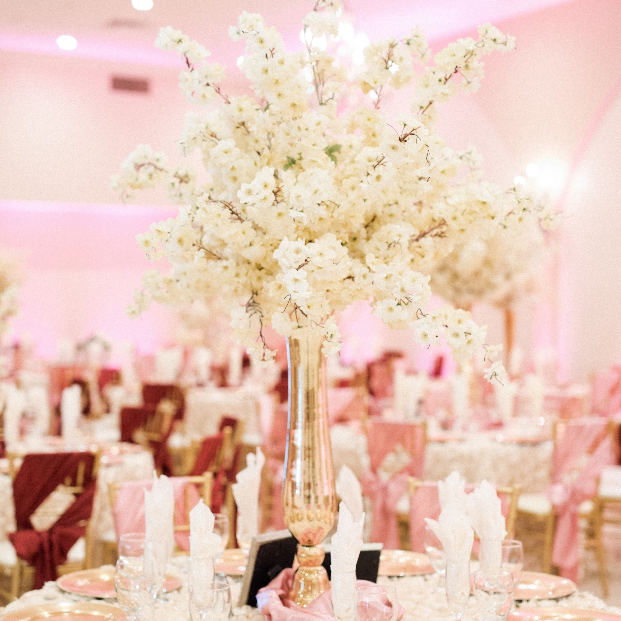 Villa Tuscana Reception Hall event showing Large white floral table centerpeice