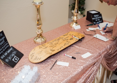 Villa Tuscana Reception Hall event showing a signing table with skateboard
