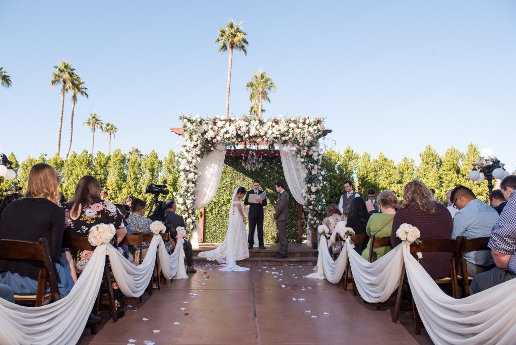 Villa Tuscana Reception Hall event showing Alejandra and Nathan outdoor wedding ceremony