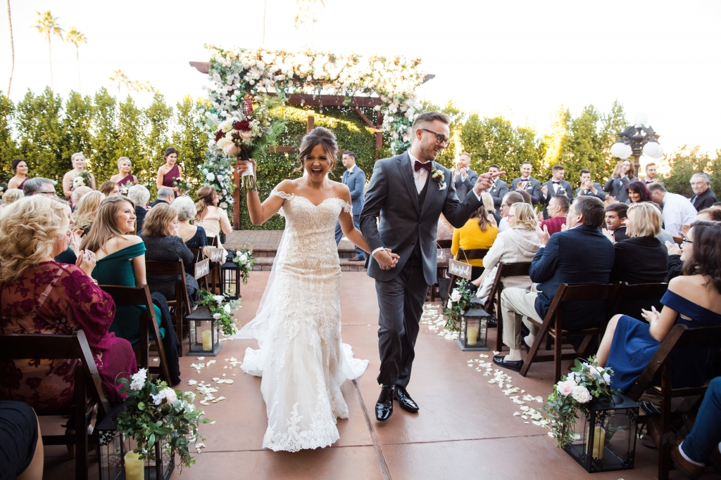 Villa Tuscana Reception Hall event showing Kira and Justin just married