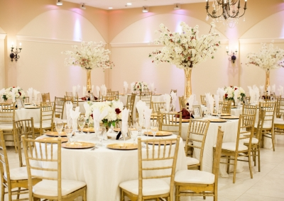 white and gold themed decor for reception