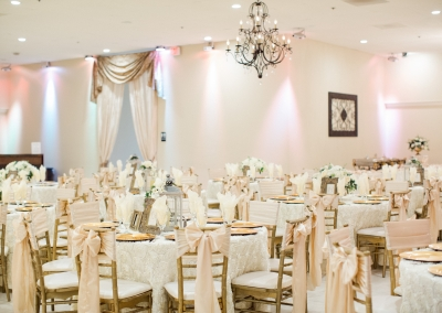 reception-decorated-in-white-rosette-linens-and-champagne-chair-ties