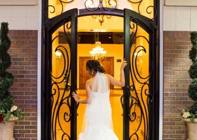bride showing off back of dress at Villa Tuscana Reception Hall wedding