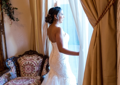 Villa Tuscana Reception Hall event showing bride posing looking out window