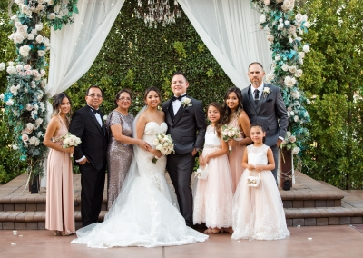 Villa Tuscana Reception Hall event showing a wedding party photo at outdoor altar