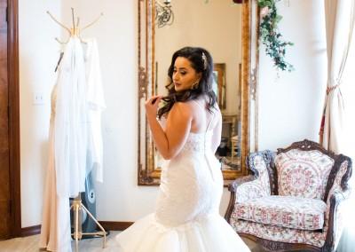 bride admiring dress