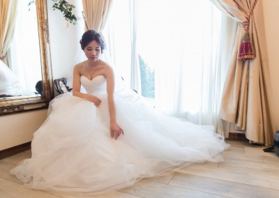 bride in dress kneeling