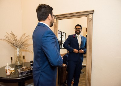 groom adjusting suit before wedding