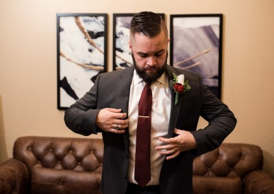 groom before wedding checking his suit