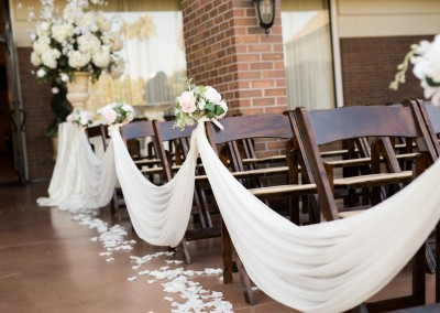 Villa Tuscana Reception Hall event showing white drapery on wedding ceremony seating