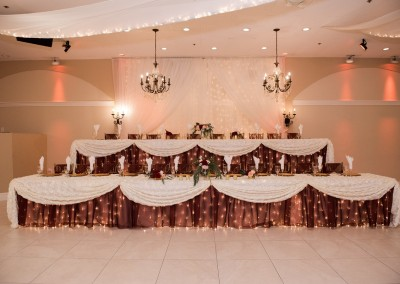 Villa Tuscana Reception Hall in mesa showing custom wedding reception decor for tables and ballroom with head table