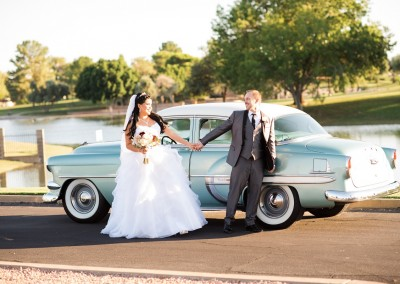 Villa Tuscana Reception Hall in mesa showing nearby park area with bride and groom by classic car on lake