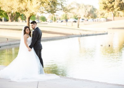 Villa Tuscana Reception Hall in mesa showing nearby park area with bride and groom by the lake