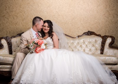 Villa Tuscana Reception Hall in mesa showing bride and groom in photo lounge on beautiful couch